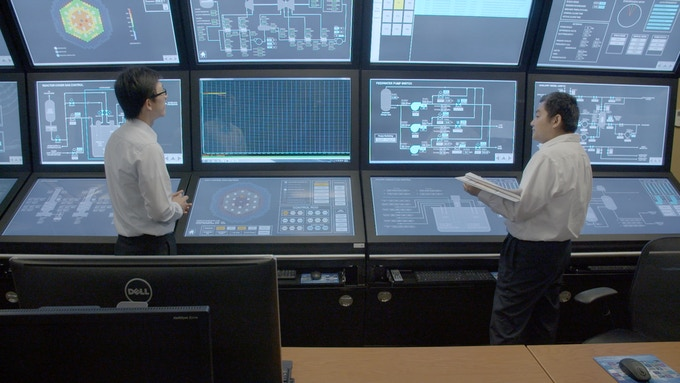 Two engineers operating a system-level reactor simulator at Terrapower
