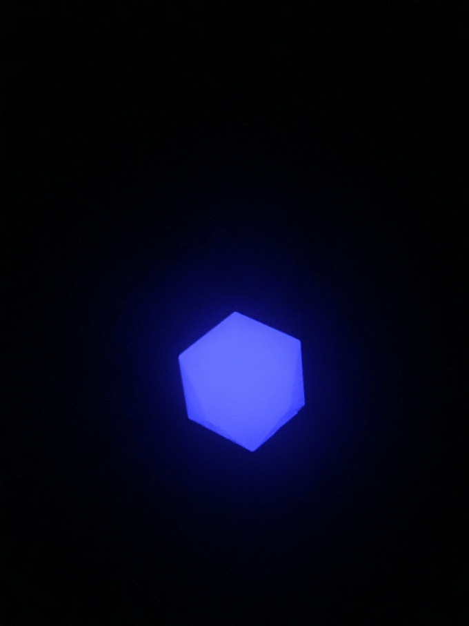 Standard D20 in the new white-dark blue pigment in the dark