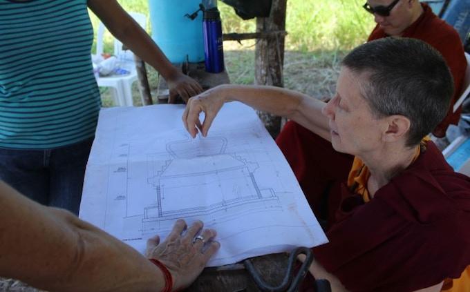 Lama Karma Chötso looking at Stupa plans