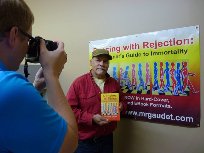 With the official banner, being photographed by the editor of our local newspaper.