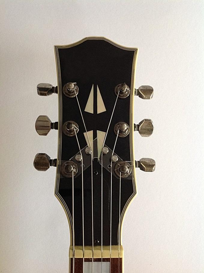 The String Butler acrylic on a Headstock