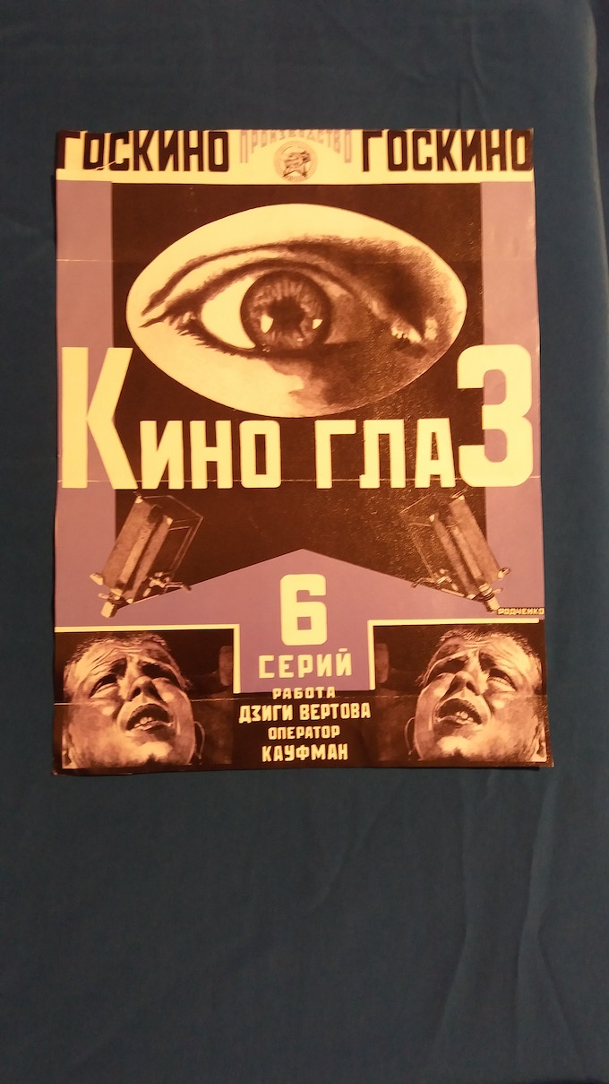 Reproduction Rodchenko/Vertov movie poster from 1920s, as seen in Sutulin's flat