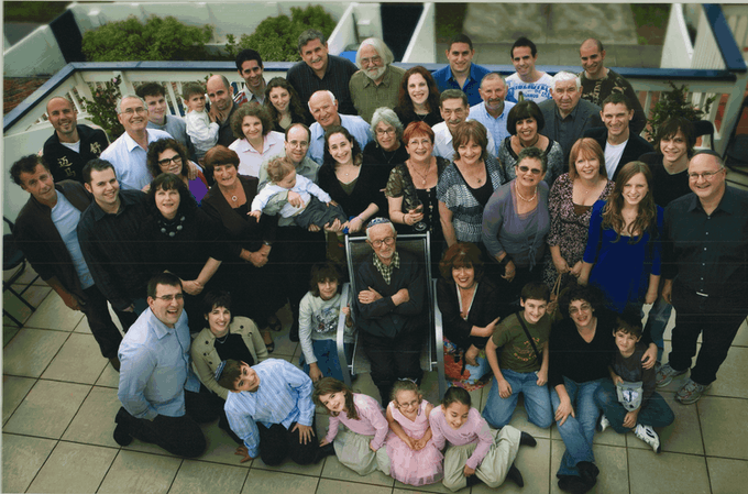 A large portion of the family celebrating Uncle Ben's 100th birthday.