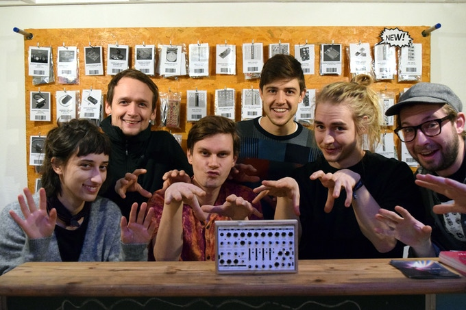 The KOMA Team in front of the Wall of Kits at Common Ground, from left to right: Lizzie, Robert, Christian, Benjamin, Otto and Wouter. Not pictured here: Tom, Hayden and Juan.