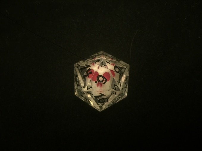 Skull element in the new white-orange pigment with red highlights and black numbers