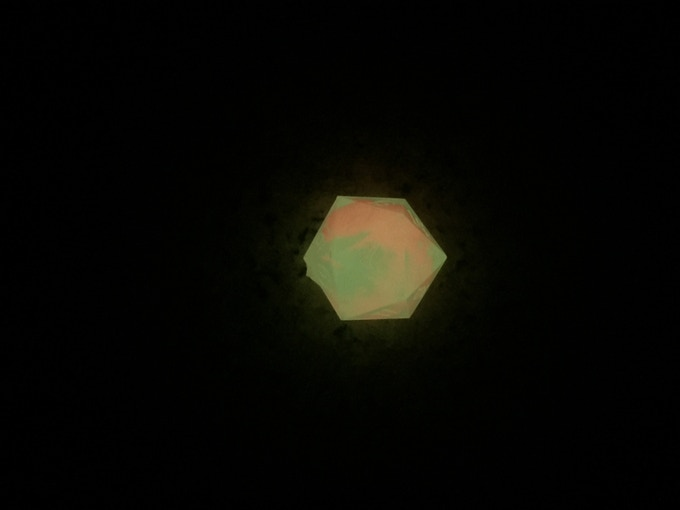 Red fire element in a die with small amount of the White-Green pigment added in the dark.