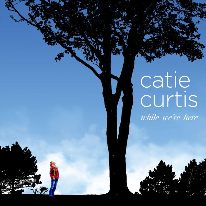 """""""While We're Here"""" is a collection of new Catie Curtis songs about endings and beginnings, about love and human connection."""
