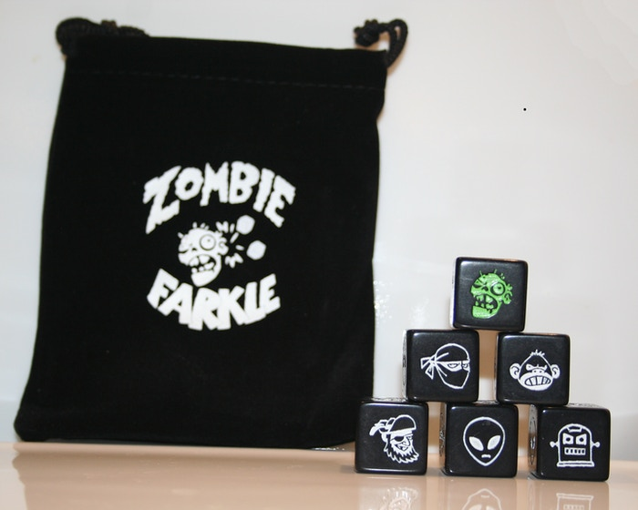 The Zombie Apocalypse is here, but Ninjas, Robots, Pirates, Monkeys, and Aliens are at our side. Roll the dice & save humanity!