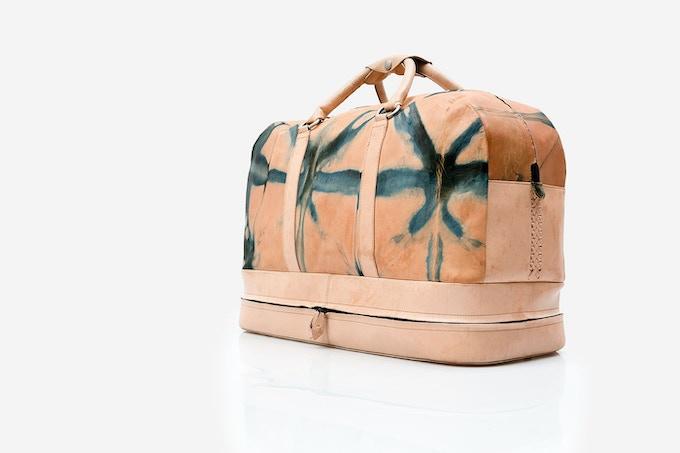 Travel bag (carry-on) · Natural vaqueta leather dyed with indigo and hand-woven braid / Bolsa de viaje · Vaqueta natural teñida con añil y trenzado tejido a mano [MX$9000]