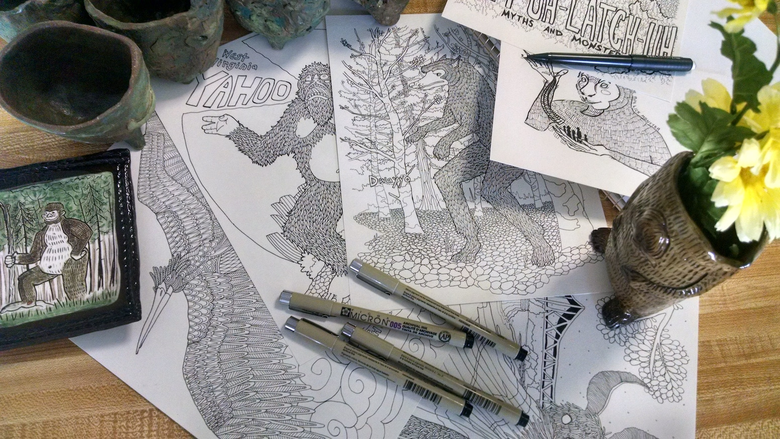a detailed coloring book full of monsters aliens and other strange appalachian cryptids