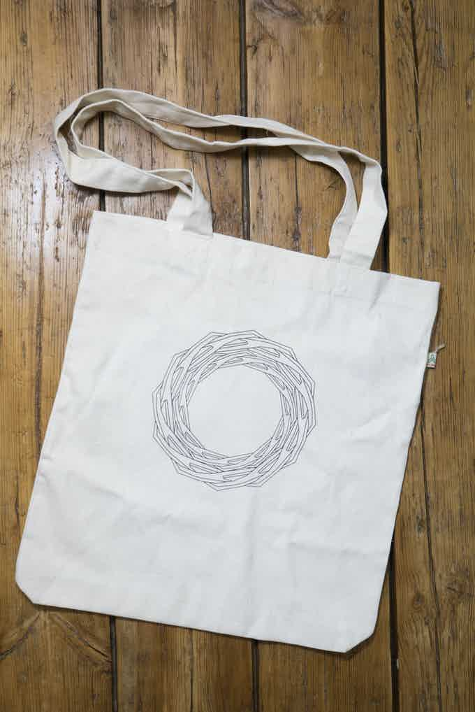 Our un-dyed canvas tote bags are 100% ethically sourced, and printed with our Nelson Chair Evolution, as well as the Full Grown Logo