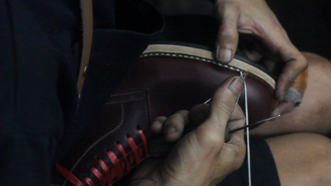 The welt - midsole - and outsole are stitched through together