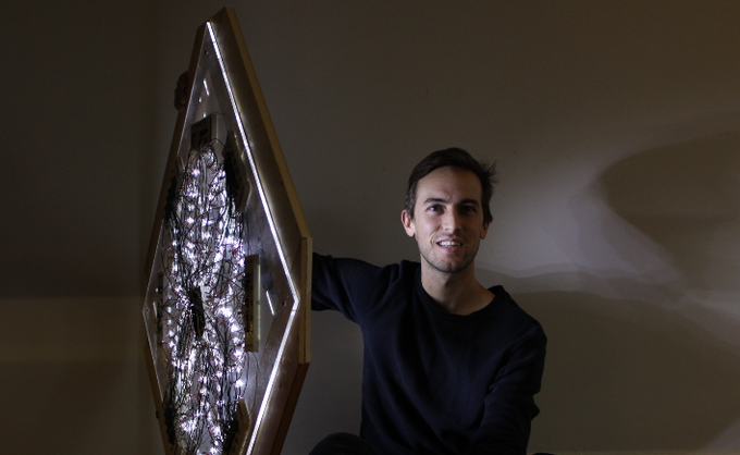 Patrick Ethen with his work (photo credit, Rachel Roze)