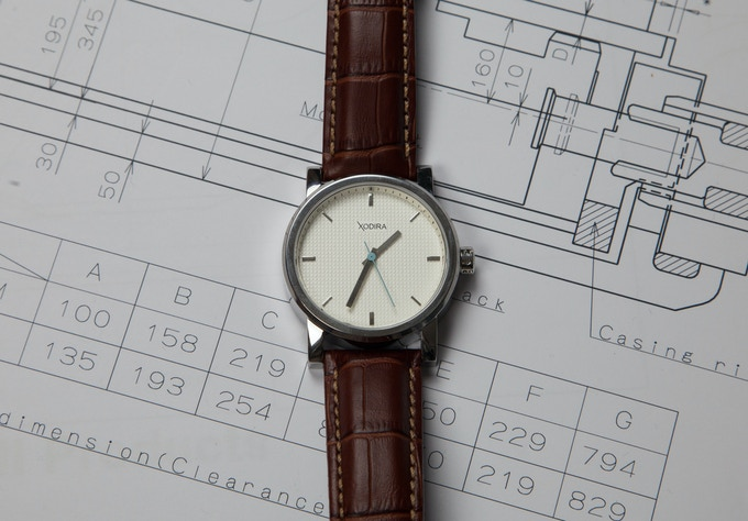 White Xodira Sweep Rox with golden brown alligator leather strap