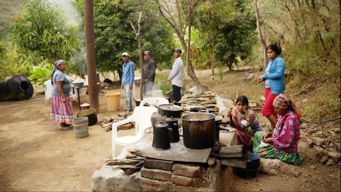Tarahumara preparing a traditional meal in their village.