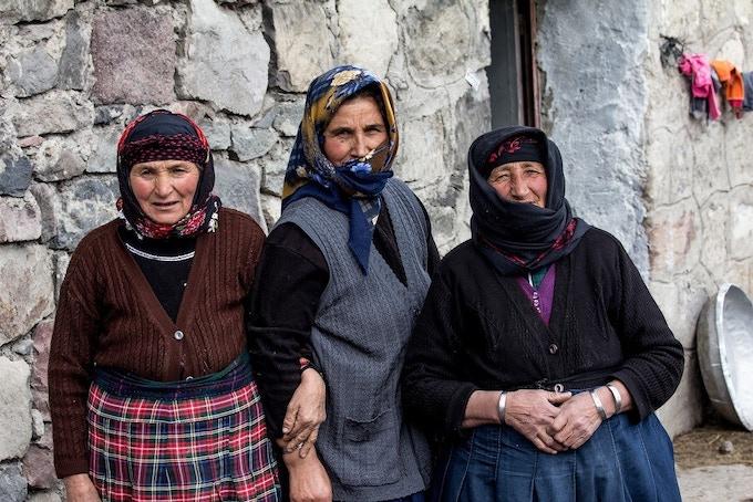"""Go that way."" Good samaritans on the remote mountain roads of northeastern Turkey. Photo by Huseyin Yilmaz."