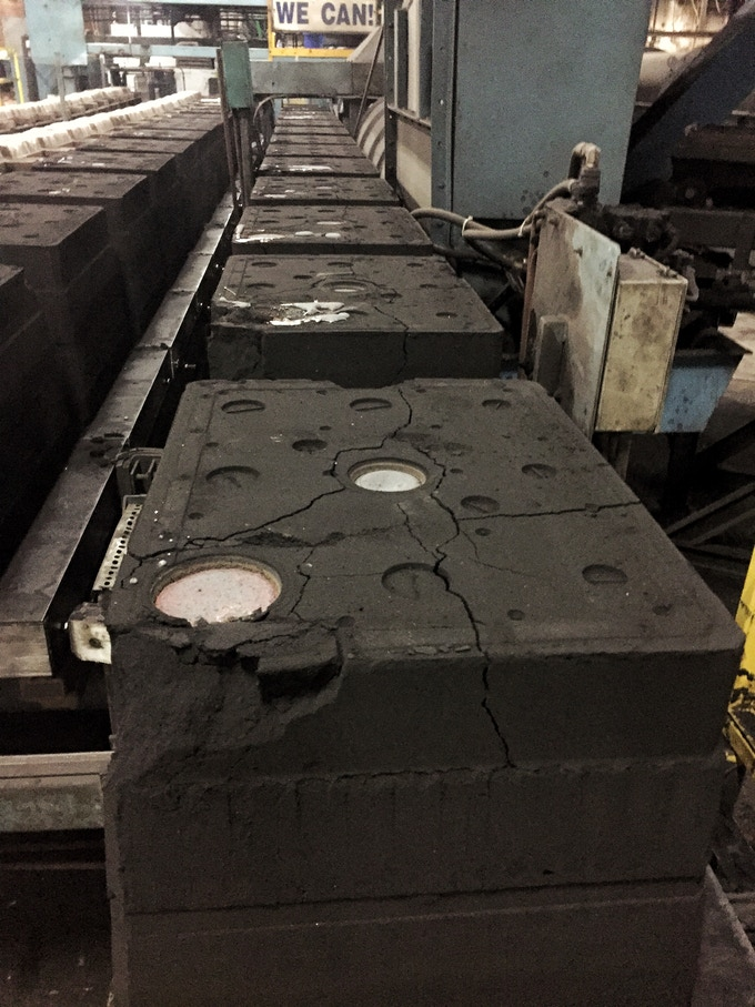 This is the assembly line that each Sindr mold goes down post pour. The top part of a mold is called a cope and the bottom a drag.