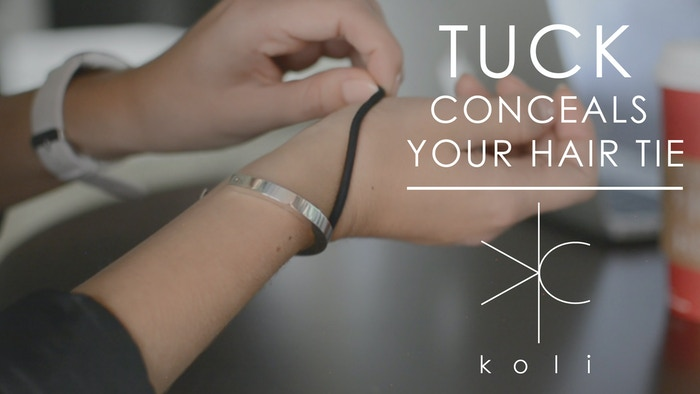 Patent Pending sleek and functional unisex cuff bracelet that keeps your hair tie exactly where you want it: unseen and on your wrist