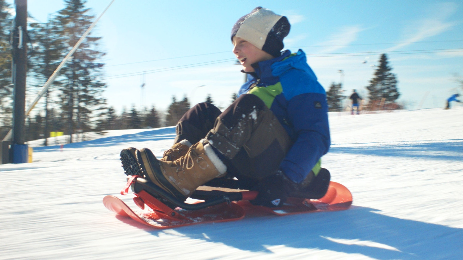 SnowBob is a revolutionary sled you actively and intuitively control by shifting your weight from side to side.