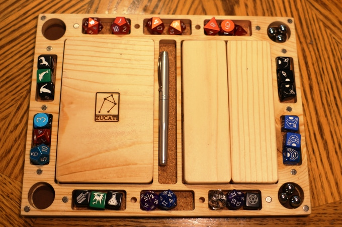 Fill the dice and FLUME panel set to the brim with your favorite polyhedral dice, standard D6 dice, pens, coins, markers and whatever else you can stuff in there. Each set comes with a matching Dice Base: FLUME.