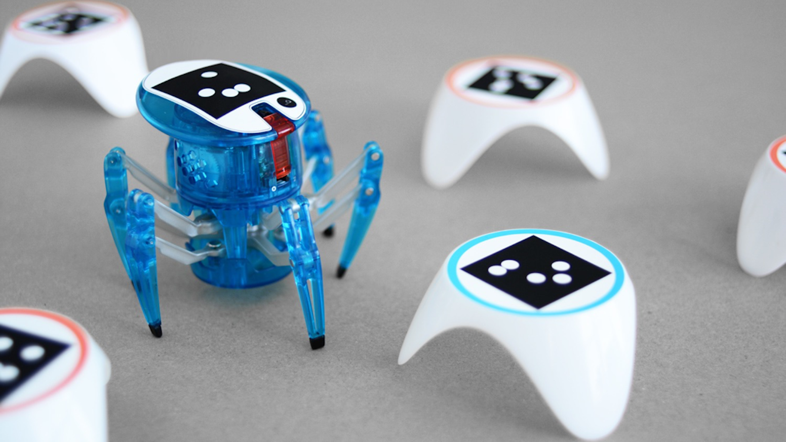 Playful immersion in advanced STEM. Teachable robots solve kid-built mazes with artificial intelligence. Supports 2 Hexbug Spiders.
