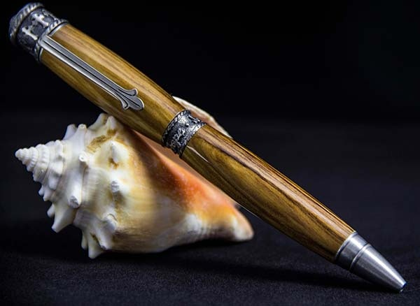 Faith Pen Shown in Bethlehem Olive Wood and Antique Pewter