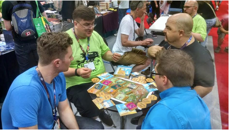 Khan of Khans demo at Gen Con 2016. That's Mark Rein-Hagen on the right, in black, and Geek & Sundry's Ben Riggs, forward right
