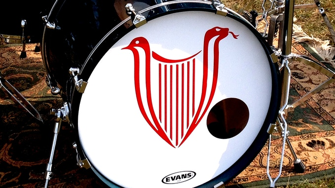 Original kick drum skin with MD logo used at gigs and in videos, signed by the band