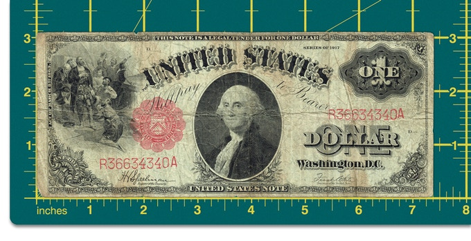 The 100 year old $1 bill, complete, and in all its glory.