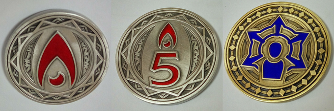 Prototype Campaign Coins. Left to Right: Heat (denominations of 1, 5), Influence