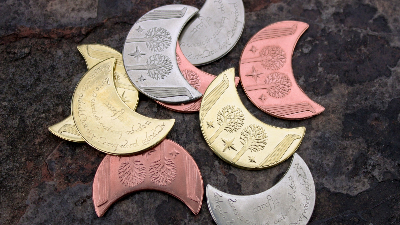Hold a piece of MIDDLE-EARTH™. We hand-engrave designs and stamp them into solid metals to make our unique coins.