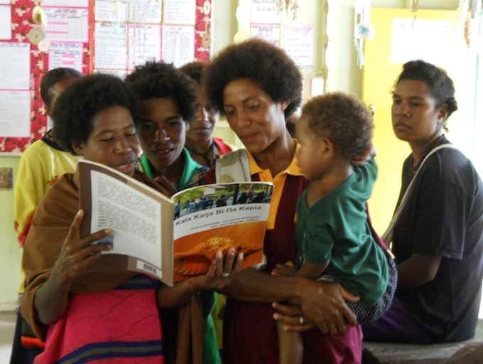 This is how important a dictionary can be for a culture that has never had one. These are Kala, from Papua New Guinea, fascinated and proud of the dictionary that has just been created for them by Christine Schreyer, one of our advisory board members.