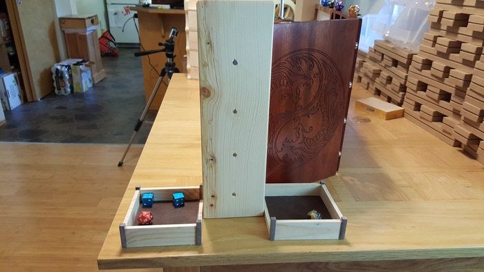 A dual dice tower, that doesn't take up ANY space behind the screen or directly in front of it... it stays TO THE SIDE