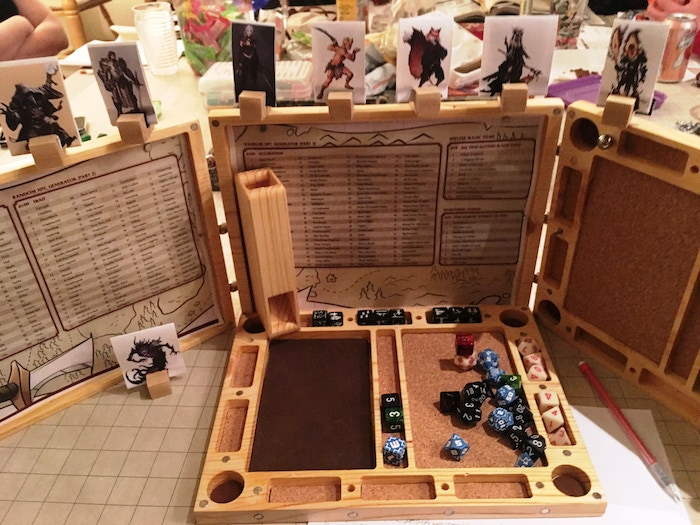 The Flume and Dice panel are compatible with the flume and provided two mini-rolling surfaces with leather and cork... oh and a whole ton of space for your GM dice! Check out the sweet iniitiative ridge and the custom markers being used.