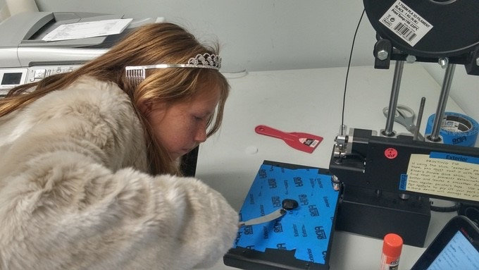 "Elementary student 3D printing parts of her ""3D Cell project"". Yes, that's a tiara. No, that's not a real fur coat."
