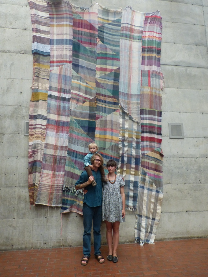 You are still scrolling!? here's my lil family in front of the biggest blanket I've managed to initiate, woven by interested visitors to the Berkeley Art Museum in 2014 -- Thanks David anything is Possible!