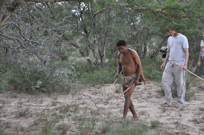 Jon and Xixao tracking in the Kalahari