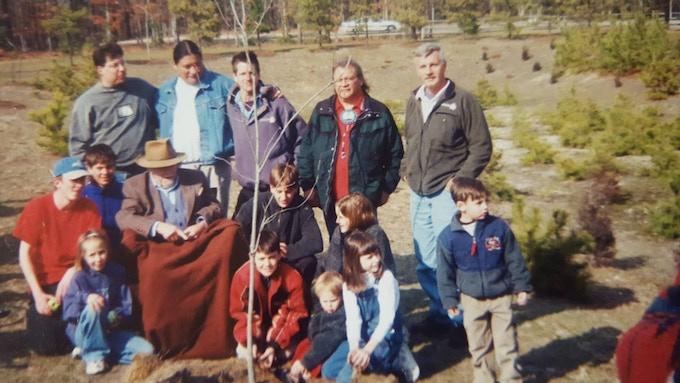 Standing: Ricardo Sierra, Tony Tenfingers, Jon Young, Jake Swamp (1940-2010), Tom Brown Jr., Sitting: Ingwe (1914-2005) and children