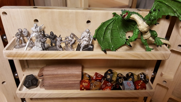 Deceptively HUGE capacity for minatures, toys, tokens dice, or whatever.... on each shelf, er CLIFF!