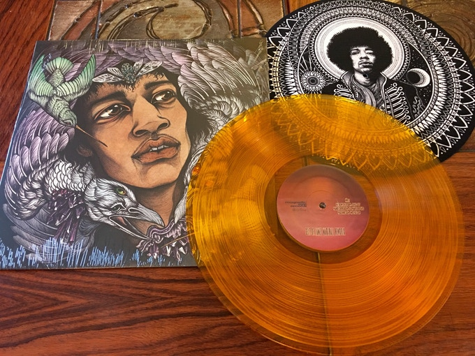 Caitlin Hackett's cover art for Best of James Marshall Hendrix and Dale Sarok's Jimi Design Slip Mat