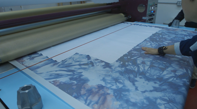 Our digital files are printed onto transfer paper and then fed through a sublimation printer. Through heat, pressure and time, the dyes are transferred permanently onto our fabric.