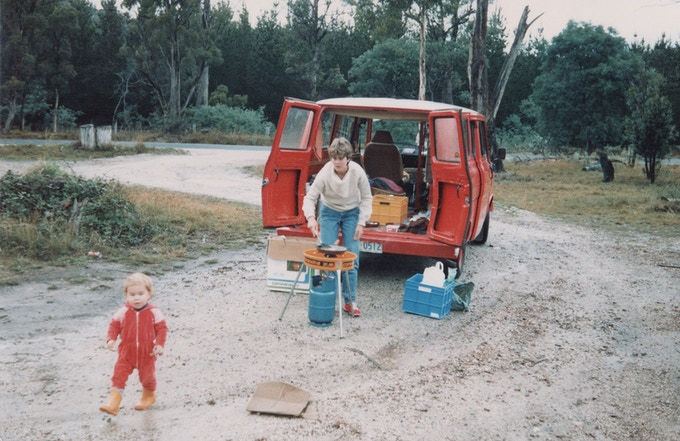 Mum and my brother Benaiah, cooking up dinner at the back of an old Australia Post van