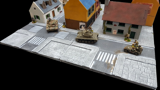A Street fight on the board above (Buildings and models included only for demonstration purposes; not part of the sets)