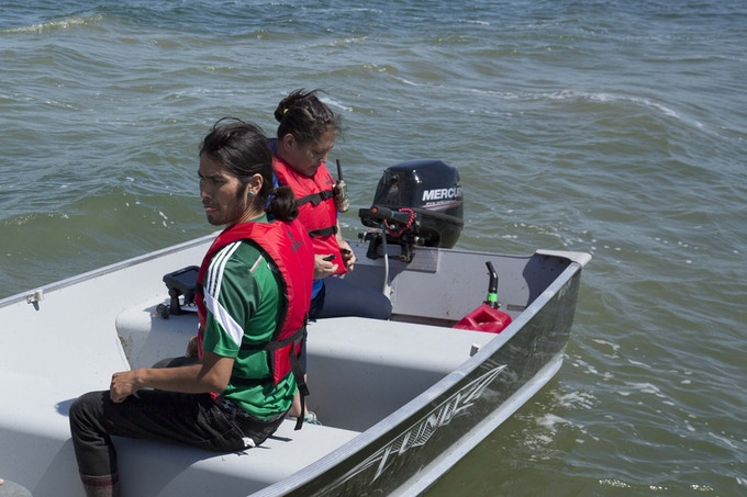 Kalen and Lissa in a boat - Searching for the murdered and missing that may be in the lake