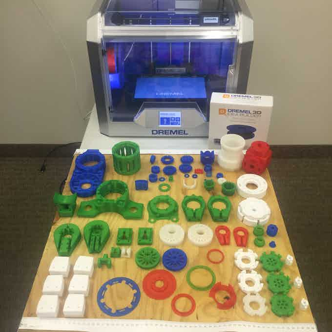Dremel 3D printer and Dexter's parts that were printed on it