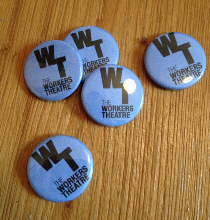 four bright blue button badges with the Workers logo