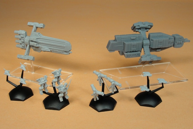 Remaster Valiant and Poseidon with older rear hull section on Acrylic Bases with Fleet Scale Exo and Fighter Squad Bases in front.