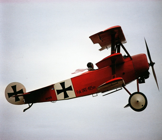Owls Head Transportation Museum Founding Trustee Kenneth Cianchette taking a spin in the Fokker Dr.I many years ago.