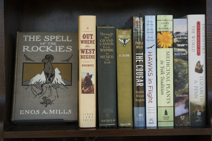 The latest publications along with aged and well-loved books populate the shelves at Buffalo Peaks Ranch. Photo by Michael Ciaglo