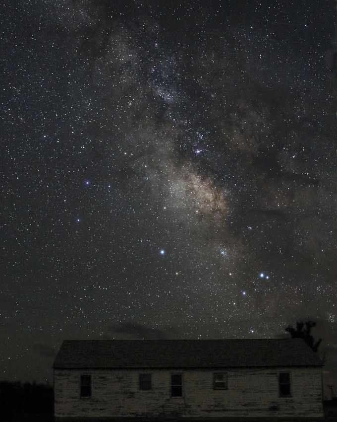 The Milky Way visible over the Cook's House at Star Night in July 2016. Photo by Jeff Kanipe